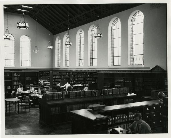 Students in the main reading room of Powell Library
