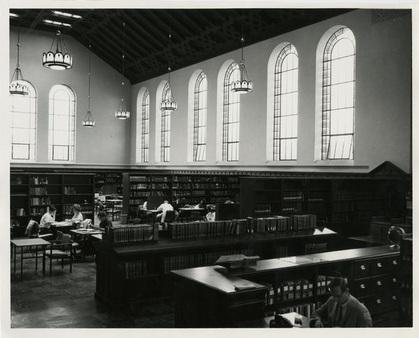 Looking west at corner of Reference desk and the Main reading room of Powell Library, 1968