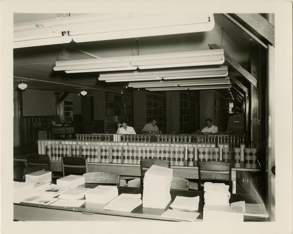 View of the library reading room from behind the reference desk