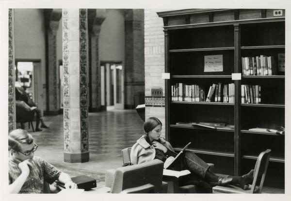 Student reading a book in Powell