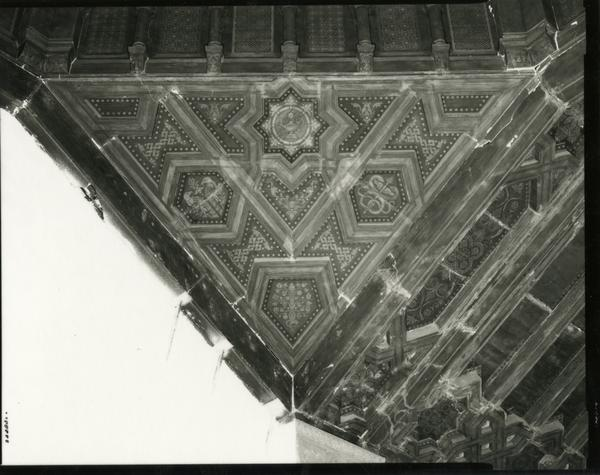 Renovation of ceiling artwork during Powell Library