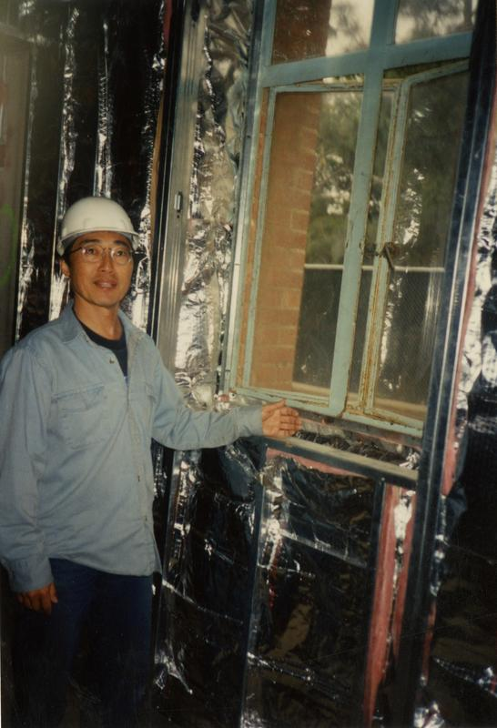 Steve Kunishima in front of the former Printing Office Window during renovation at Powell Library