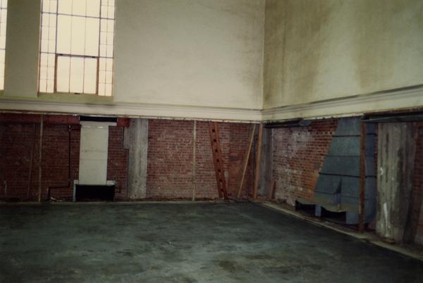 Interior wall of Powell Library during renovation