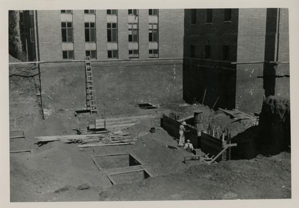 Workers building the Powell Library Stack Extension