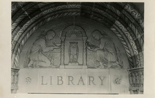 Stone carvings above Powell Library entrance