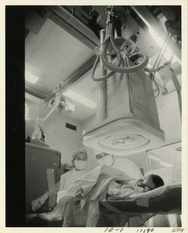 Doctor and nurse running a test on infant patient