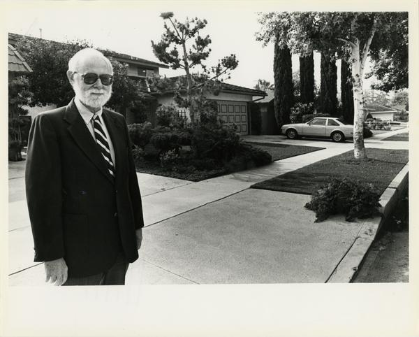 Photo of man outside of house