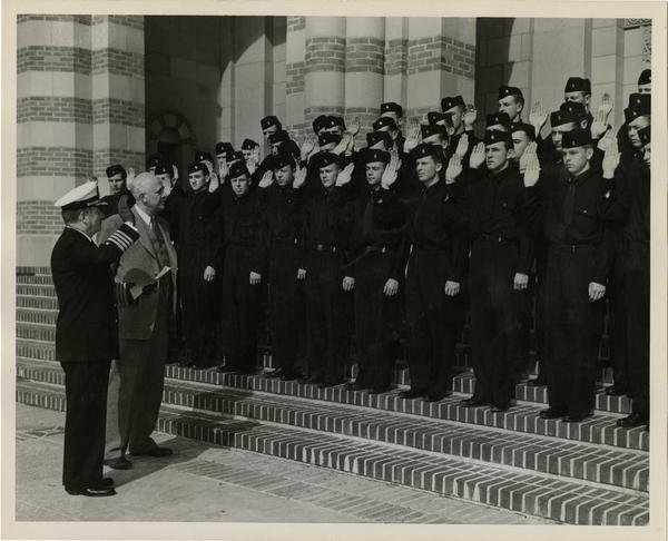 Captain William C. Barker and Provost Clarence A. Dykstra with Navy ROTC cadets in front of Royce Hall