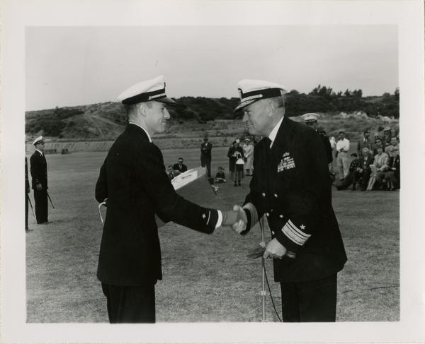 Captain L.C. Grannis congratulating naval ensign