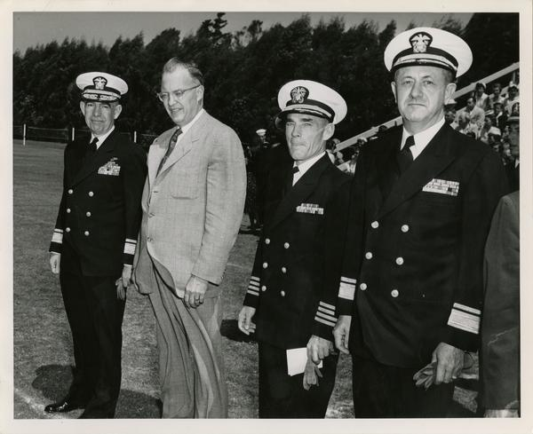 Rear Admiral George C. Dyer, Chancellor Raymond B. Allen, Captain Joseph W. Adams, and Rear Admiral. C.L. C. Atkeson waiting for annual review of NROTC unit, June 5, 1954
