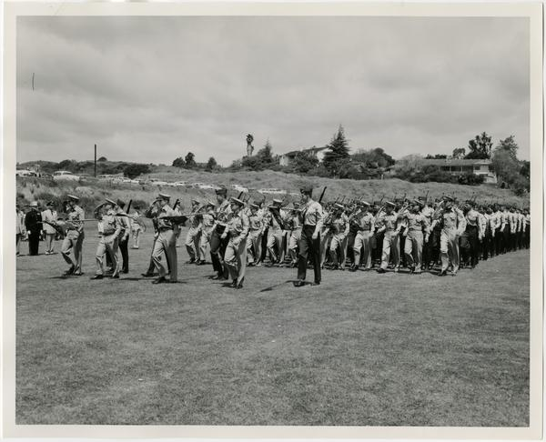 Marine Unit of the UCLA ROTC, passing in review during the Annual Joint ROTC Review, at the University of California Los Angeles, May 2, 1957.