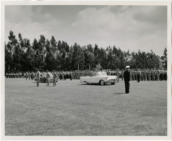 Chancellor Raymond B. Allen, Dean David F. Jackey with Colonel R. Lynch during the Annual ROTC Review, may 2, 1957