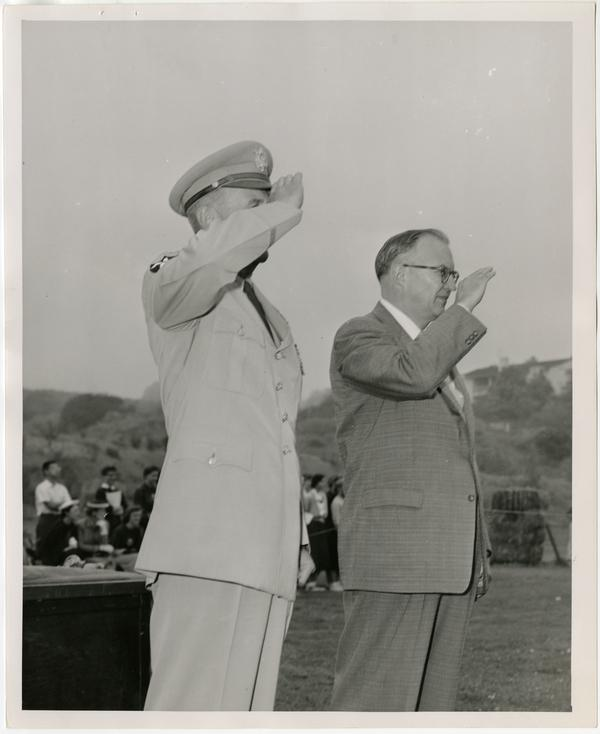 Photo of Chancellor Raymond B. Allen and officer saluting, ca. 1956