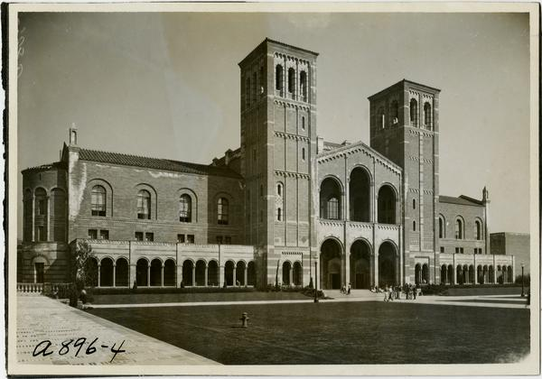 People sitting and walking outside of Royce Hall