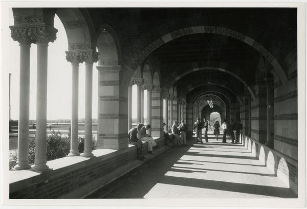 View of people within arcade of Royce Hall