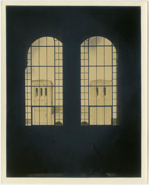 Looking through Powell Library windows at Royce Hall Towers, 1930