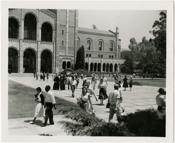 People walking in Royce Hall quad, ca. July 1958