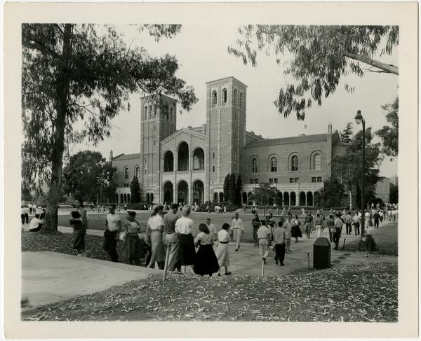 Students walking near Royce Hall, ca. 1955