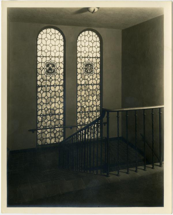 View of stained glass windows near staircase within Royce Hall, ca. 1930