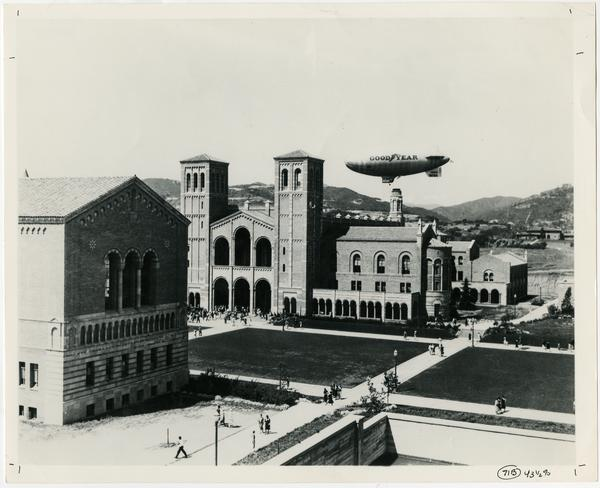 View of Powell Library and Royce Hall as Good Year Blimp flies by