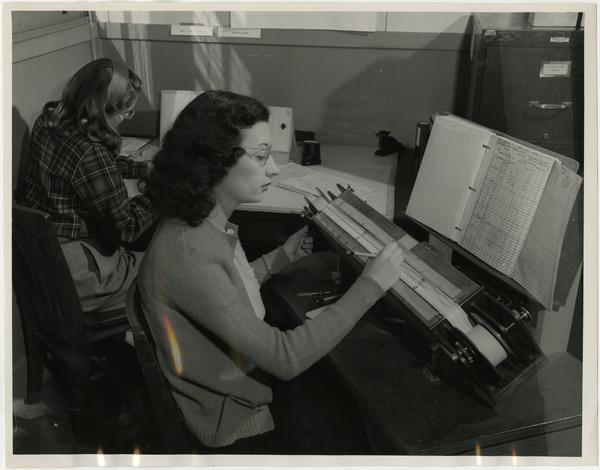 """Laboratory technicians, Elizabeth Ann Little and Gail Slack assembling statistics from 35mm recordings of sound made in an oscillograph aboard the SS """"Scripps"""", ca. 1946"""
