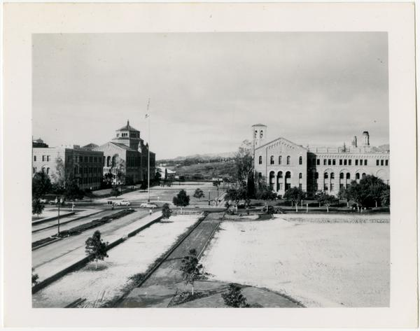 View of Dickson Court after snowfall with Humanities Hall, Powell Library, and Haines Hall in background, ca January 1949