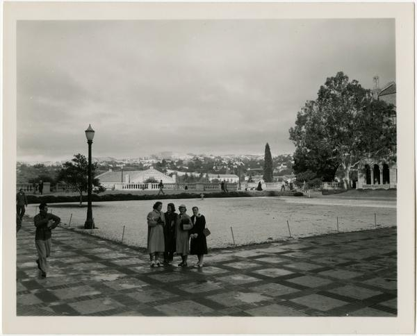 Group of women pose for photo in Royce Hall quad, ca. 1949