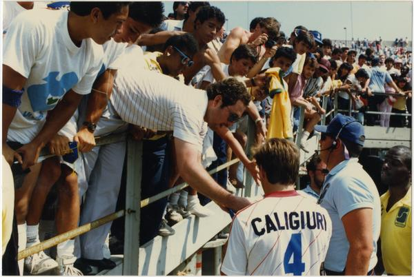 Paul Caligiuri signing autographs for fans at FIFA World Cup All-Star Game, July 1986
