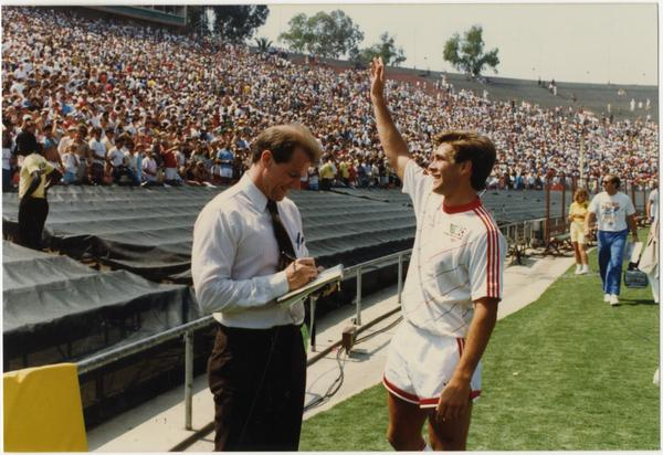 UCLA team member, Paul Caligiuri, waving to crowd at 1986 FIFA World Cup All-Star Game, July 1986