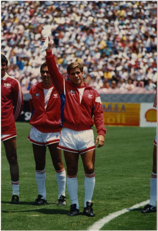 UCLA team member, Paul Caligiuri, raising arm at 1986 FIFA World Cup All-Star Game, July 1986