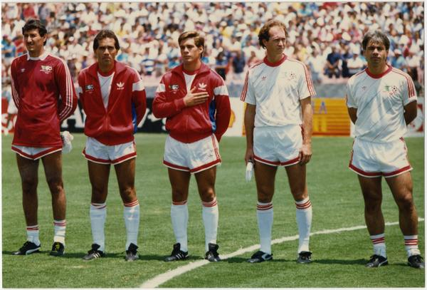 UCLA team member, Paul Caligiuri, holding hand over chest at 1986 FIFA World Cup All-Star Game , July 1986