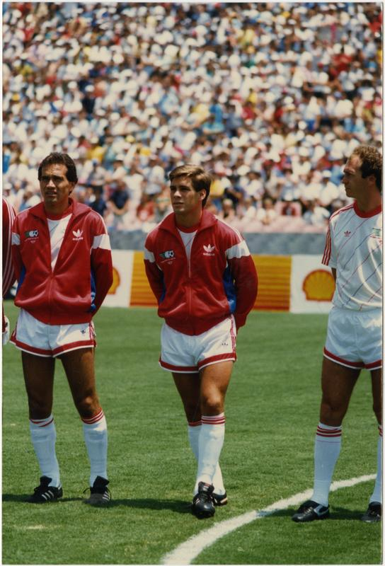 UCLA team member, Paul Caligiuri, standing beside his teammates at 1986 FIFA World Cup All-Star Game , July 1986