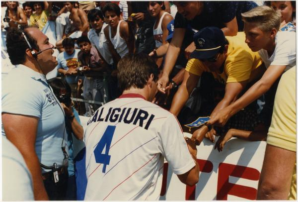 UCLA team member, Paul Caligiuri, signing autographs at 1986 FIFA World Cup All-Star Game , July 1986