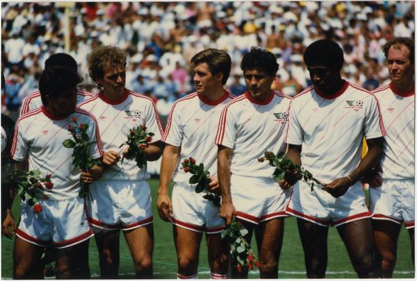UCLA team member, Paul Caligiuri, standing in center with teammates at 1986 FIFA World Cup All-Star Game , July 1986