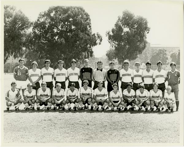1983 UCLA Soccer: (Back row l-r): Asst. Coach Steve Sampson, Paul Krumpe, Pat Miler, Eric Biefeld, David Drummond, Drew Leonard, Tim Harris, David Vanole, Roland Schmid, Dale Ervine, Mike Arya, Grant Clark and Sigi Schmid, Head Coach. (Front row, l-r): Asst. Coach Tibor Pelle, Doug Swanson, Scott Barbour, Peter Houtzager, Afshin Ghotbi, Jeff Hooker, Paul Califuiri, Shawn Del Grande, Tom Silvas, Bill Nelson and Greg Holin (redshirt) and ballboy.