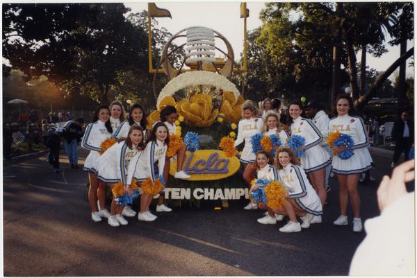 Spirit Squad posing in front of UCLA champion float