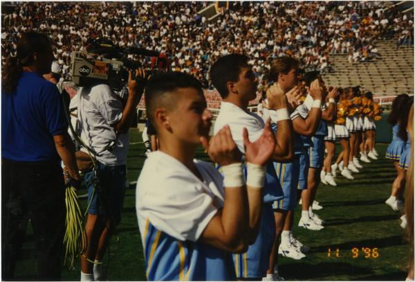 Spirit Squad cheering on sideline, ca. 1996