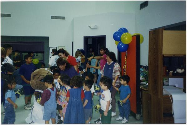 Spirit Squad mascot with children