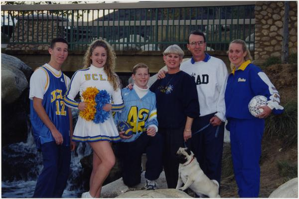 Spirit Squad member with group of people in UCLA regalia