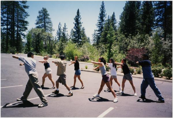 Spirit Squad stretching in parking lot, ca. July 1998
