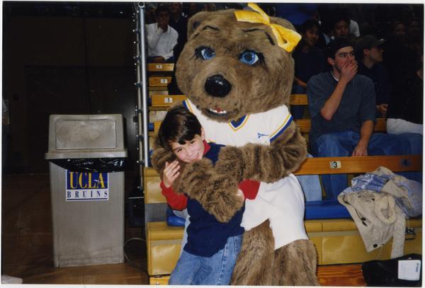 Josie Bruin mascot hugging child