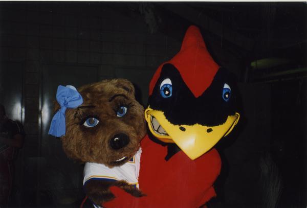 Josie Bruin with Cardinal mascot, ca. April 1997