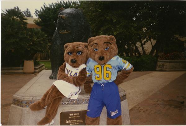 Joe and Josie Bruin posing next to Bruin sculpture
