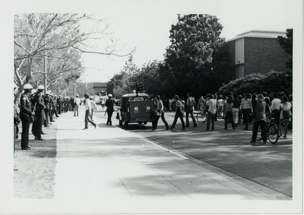 Police and student protestors lined up on street, May 16, 1969