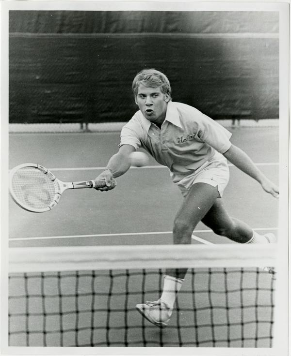 NCAA champion, Billy Martin, hitting ball with raquet