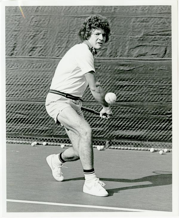 NCAA champion, Ferdi Taygan, hitting ball with raquet, ca. 1970s