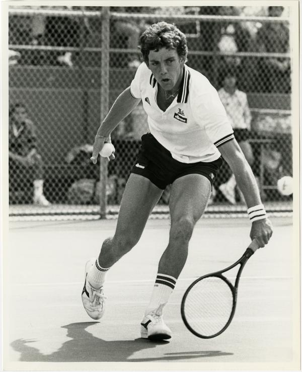 UCLA tennis team member, Robbie Venter, hitting ball with raquet, ca. 1982