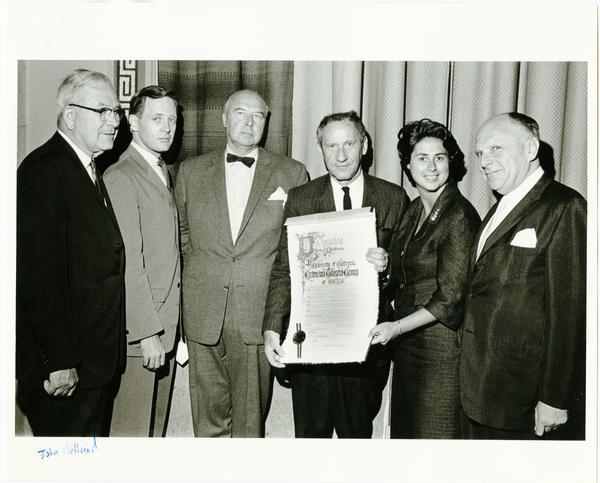 Theater group holding declaration of Extension Theatre Group, ca. 1966