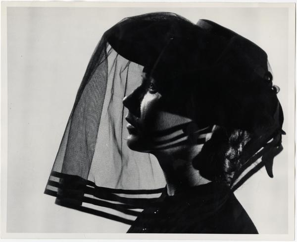 Woman in black with veil over face in Theater Arts Department production scene