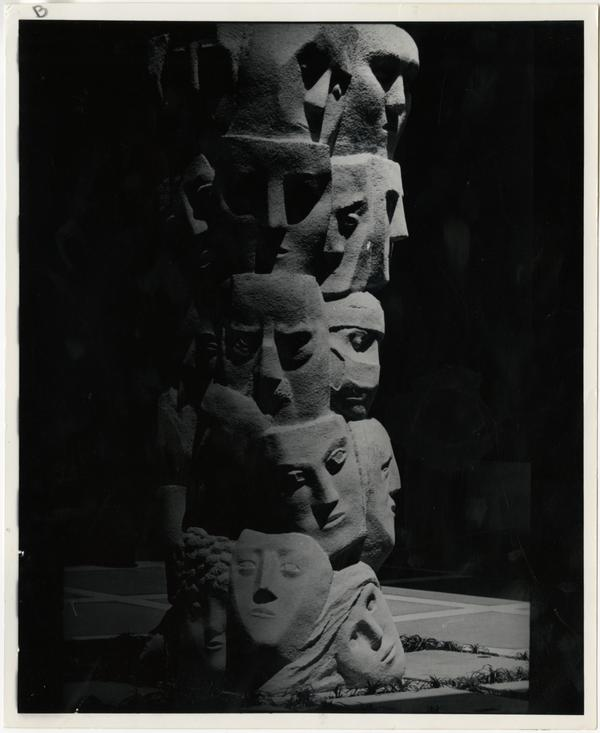 """""""Tower of Masks"""" statue scultped by Anna Mahler in Theater Arts court"""